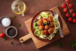 sneak vegetables onto childs plate zoodles and spaghetti